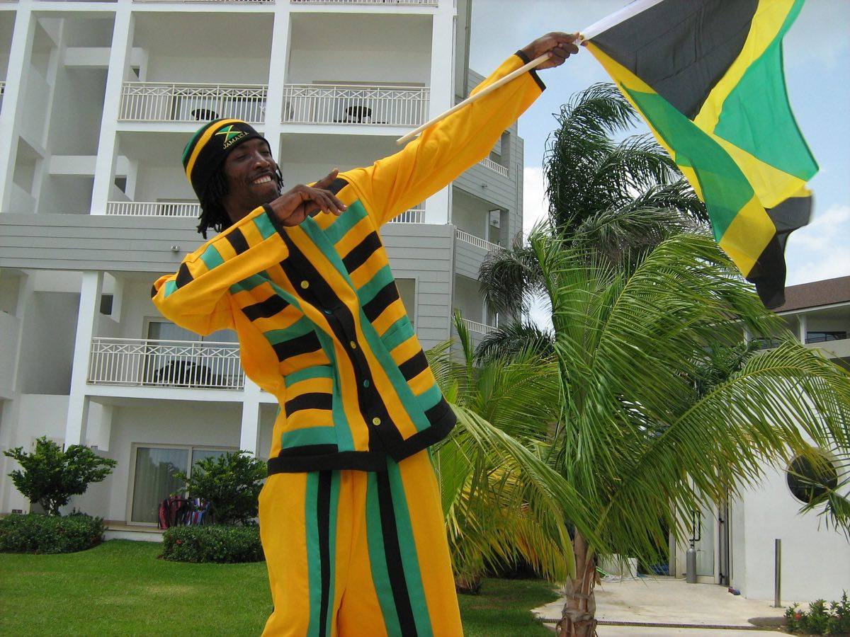 Hotels in Jamaica Boy with Jamaica Flag Waving