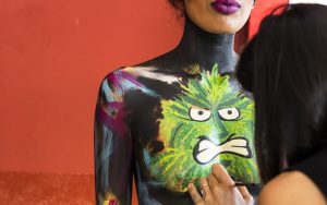 Bodyart weed artist working with bodyart weed model - cannabis show, latin america